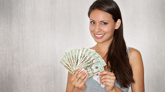 a woman holding cash from convenient installment loan